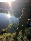 Солнце и рыбак